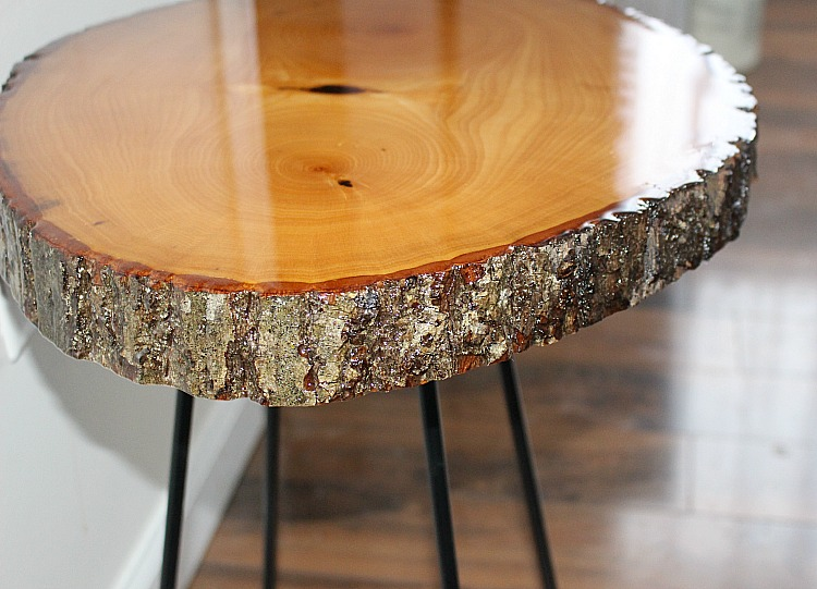 DIY wood slice table covered in resin by our crafty mom