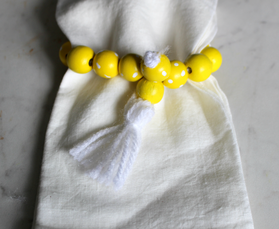 Create Your Own Farmhouse Wood Bead Napkin Rings Our Crafty Mom #woodbeads #diynapkinrings #napkinrings #ourcraftymom