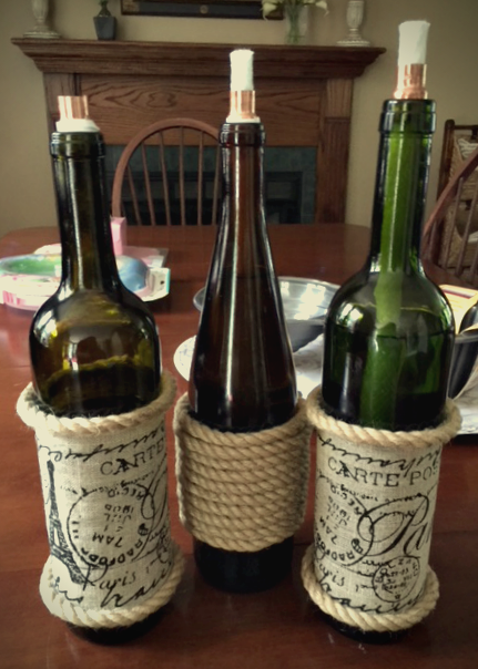 How To Make DIY Wine Bottle Tiki Torches And Solar Lights Our Crafty Mom #farmhousehens #winebottlecrafts #repurposed #tikitorches #solarlights