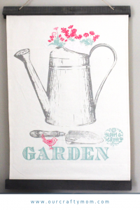 How To Make A Watering Can Spring Banner #ourcraftymom #springbanner #springdecor #chalkcouture