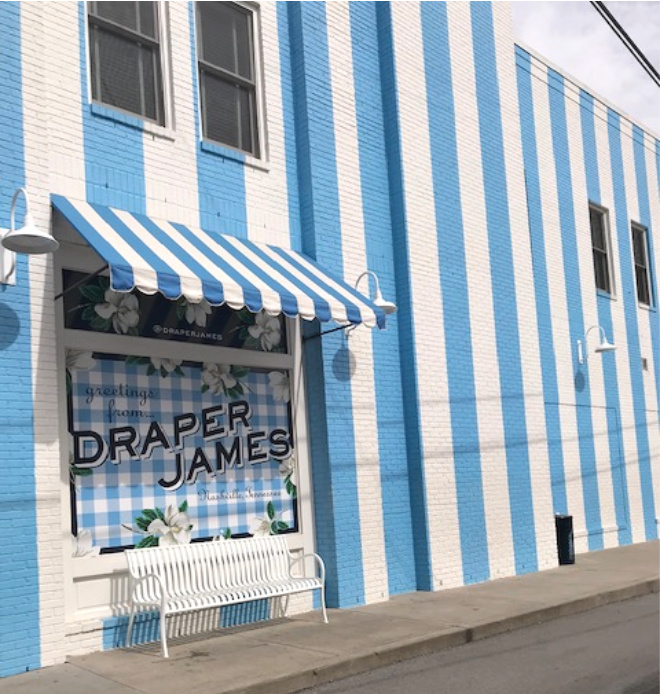Draper James storefront blue and white striped awning