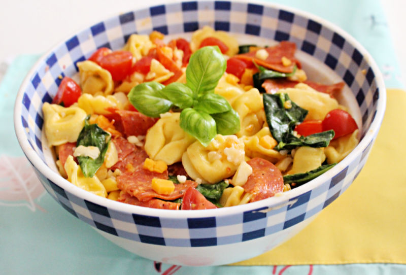 tuscan pasta salad in blue gingham bowl
