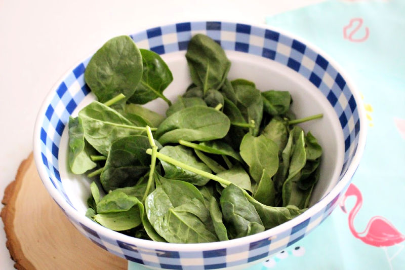 spinach in gingham bowl