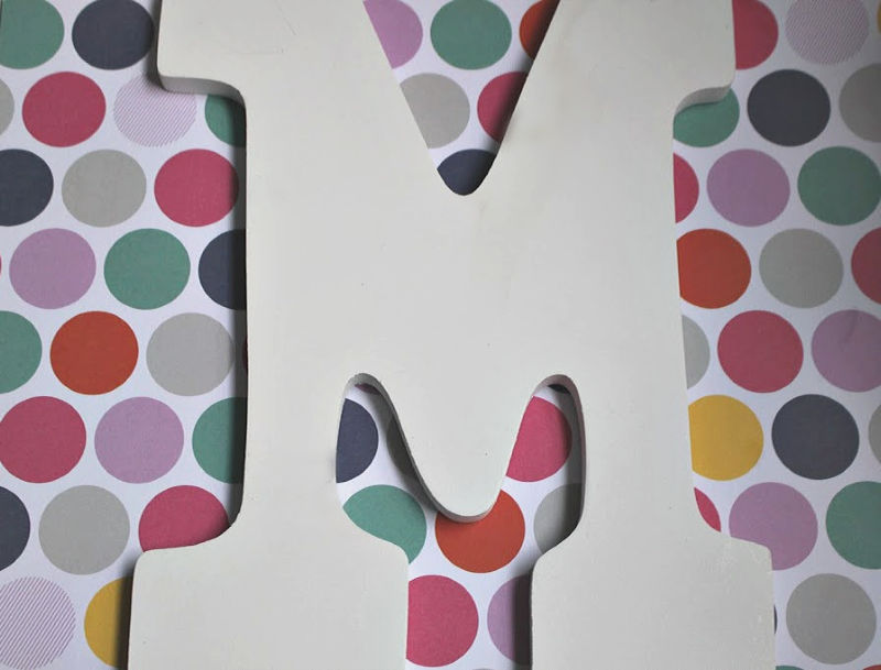 wood letter M on polka dot paper