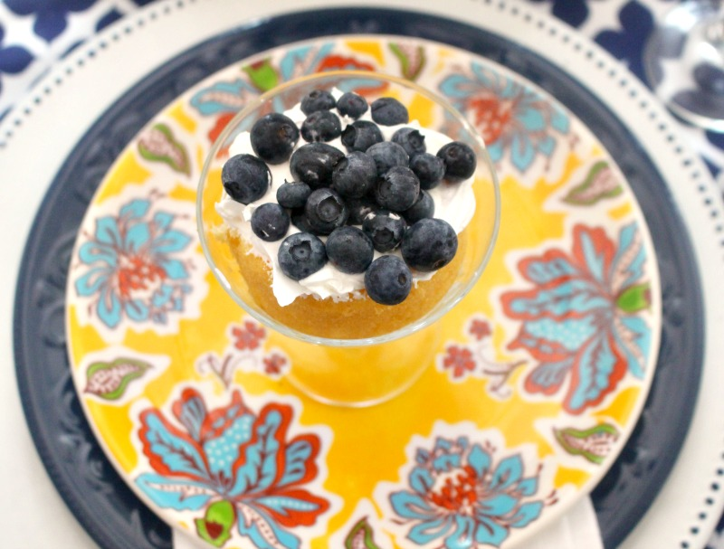close up of blueberries on summer floral dishes