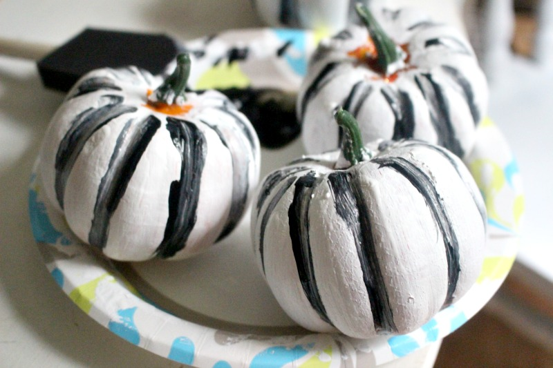 dollar store white pumpkins with black paint