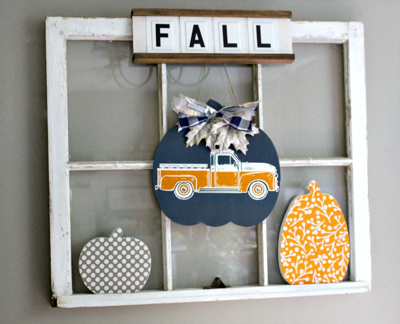 Antique window with diy wood pumpkins