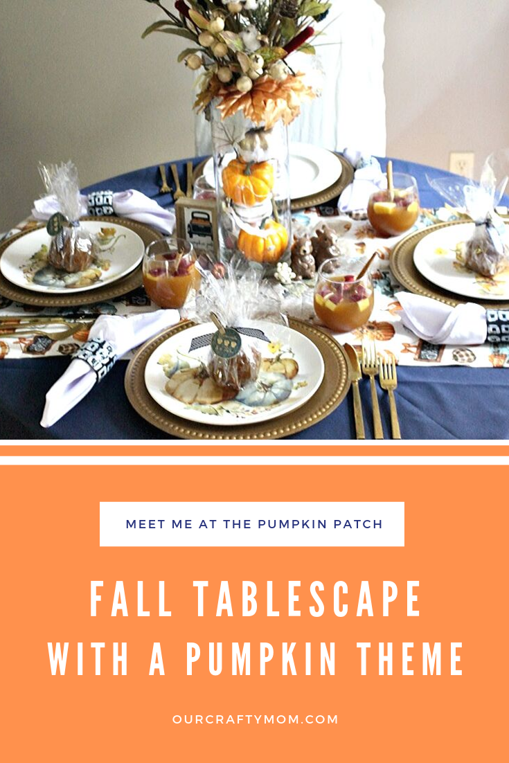 fall tablescape with navy tablecloth and pumpkin dishes