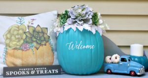 Teal Pumpkin Project succulent pumpkin on porch with pillow and small truck