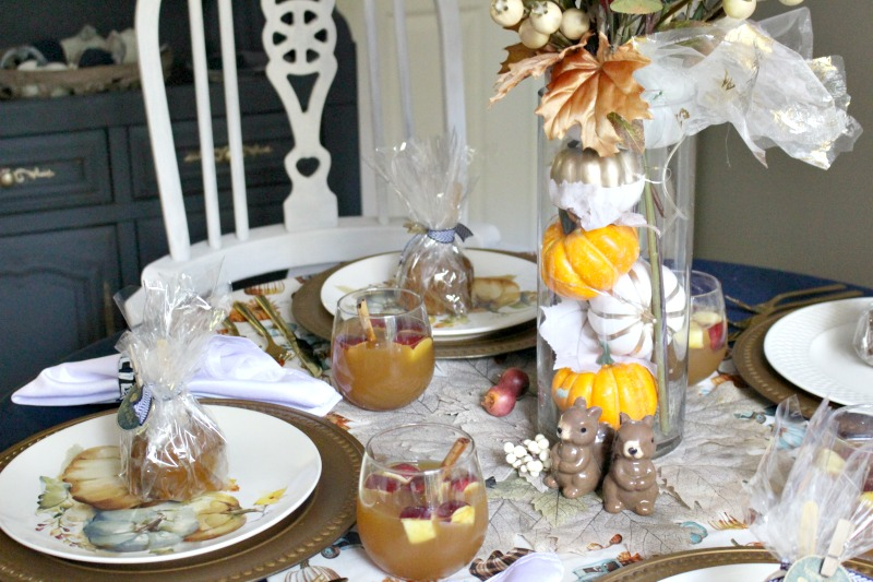 fall tablescape with apple cider and pumpkin patch