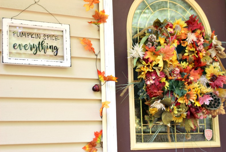 fall wreath and pumpkin spice sign