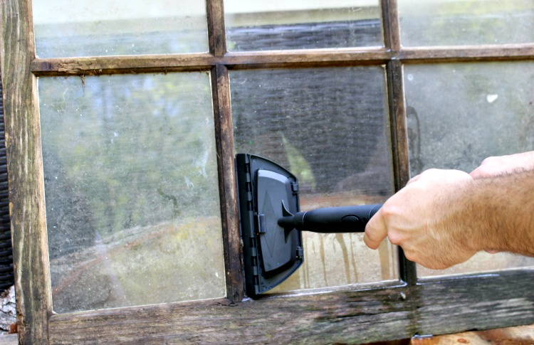 cleaning an old window with autoright steam machine