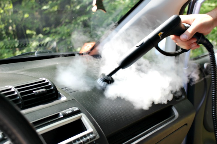 cleaning the dashboard with the homeright auto steam cleaner