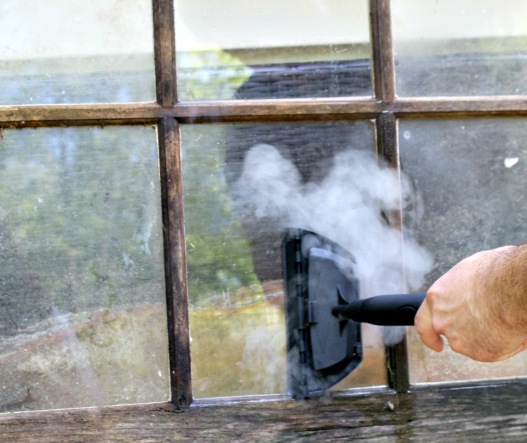 cleaning window with steam machine homeright