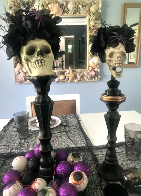 halloween table with skull candle holders