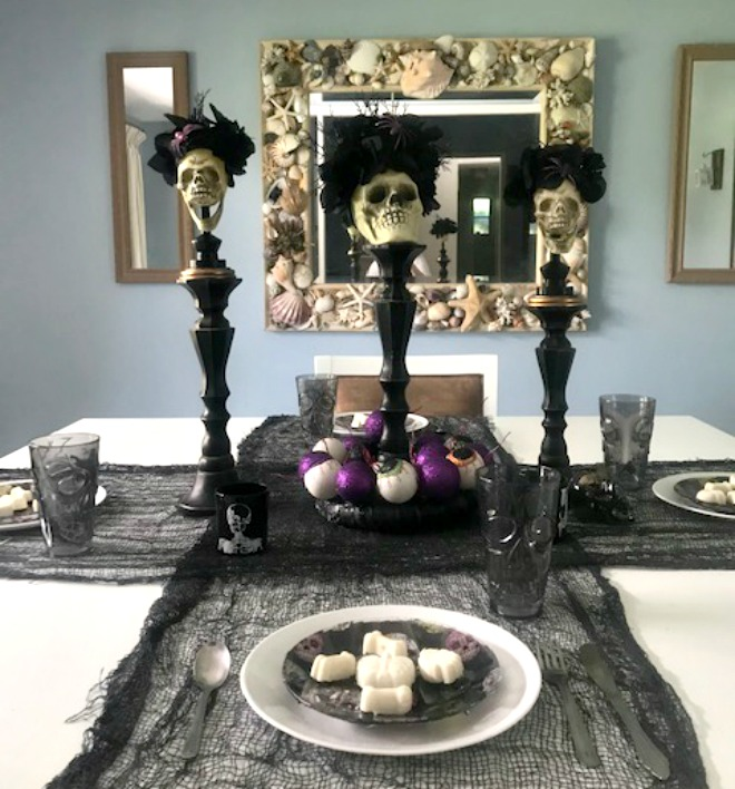 halloween table with sugar skulls day of the dead theme