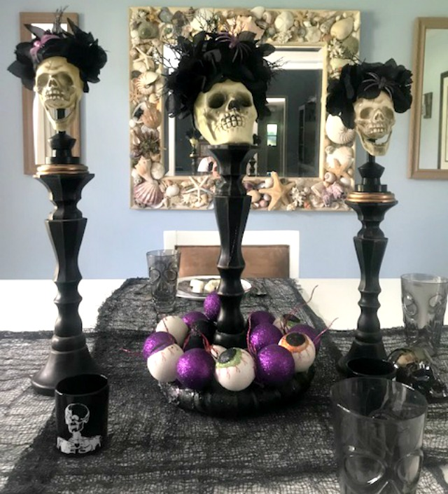 set of three skull candle holders