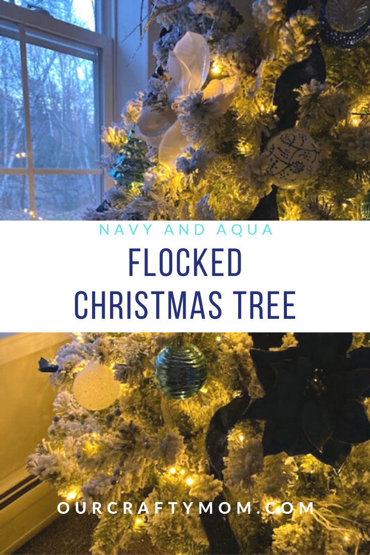 flocked christmas tree with navy and aqua decorations