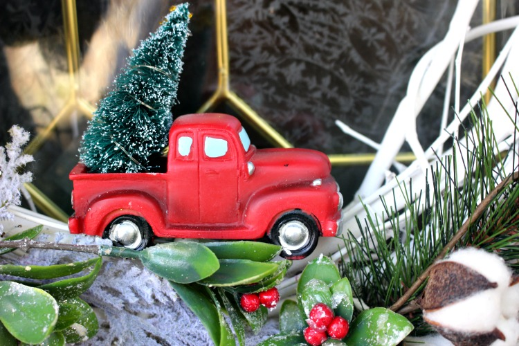 close up of little red truck on wreath