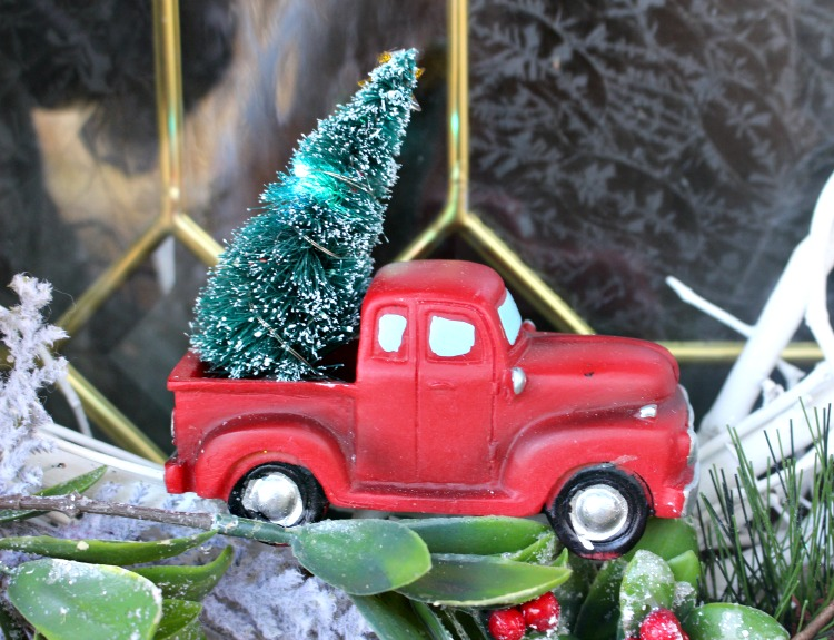 close up of little red truck with lights on