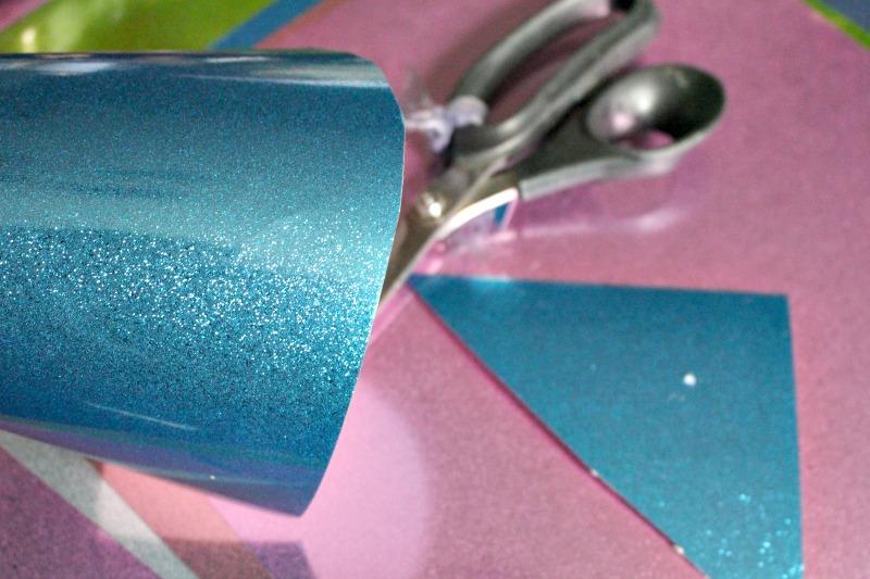 glitter paper cones being cut