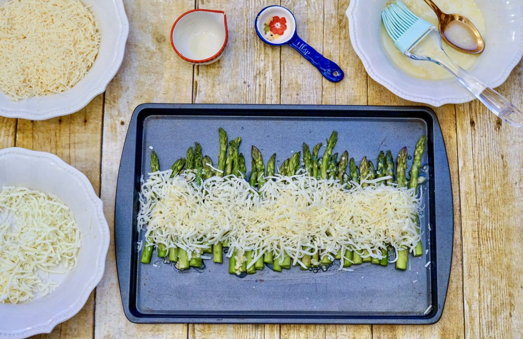 asparagus with cheese on pan