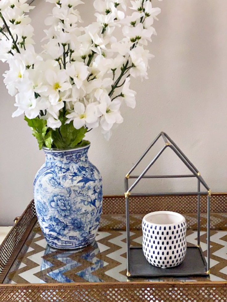 diy chinoiserie vase next to house candle holder