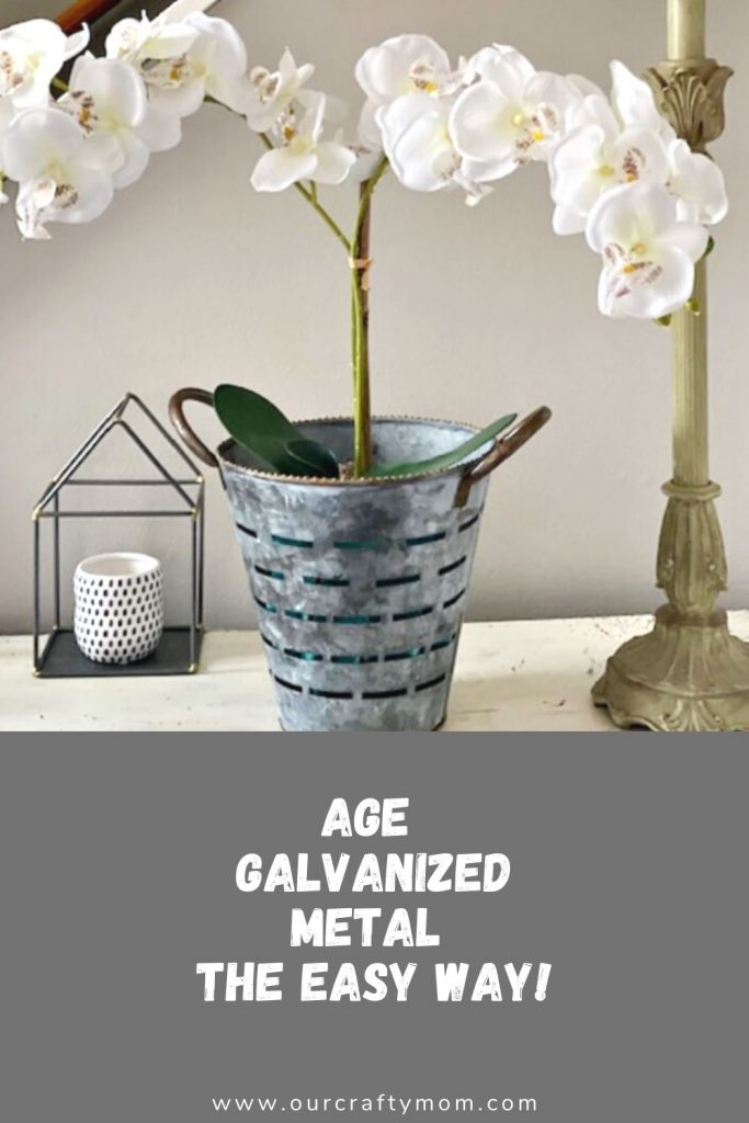 olive bucket with orchid
