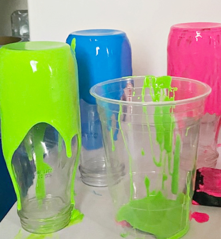 paint dipped jars drying