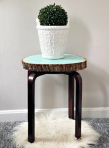 painted glow table shown in living room
