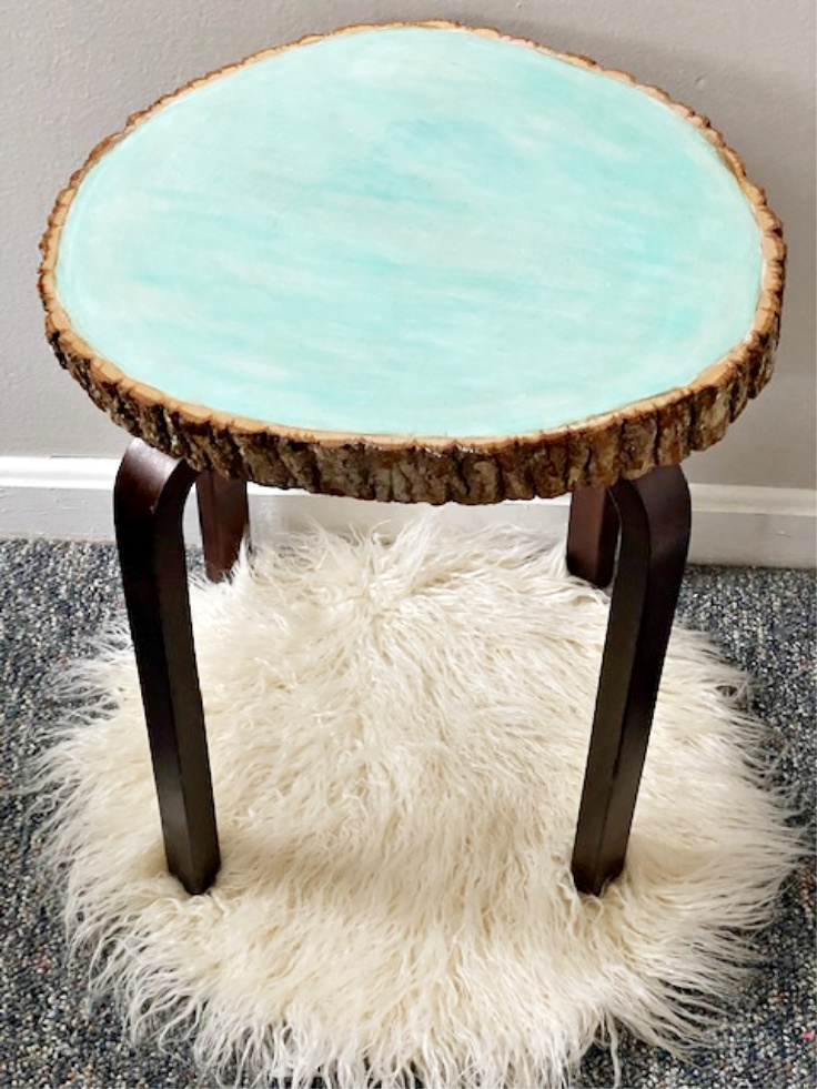 painted glow wood slice on wood side table
