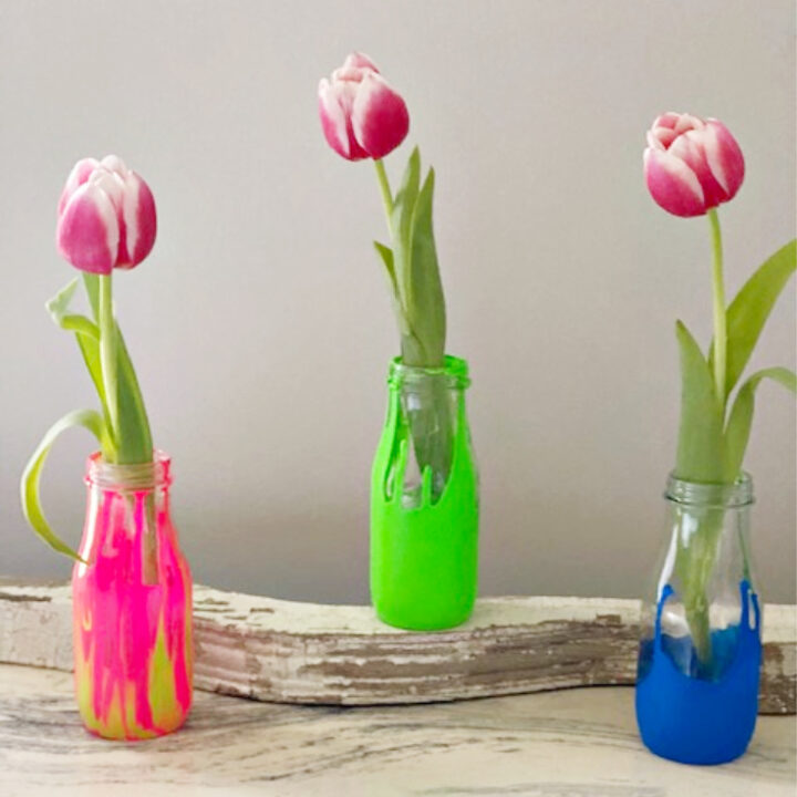 starbucks bottles used as vases with tulips