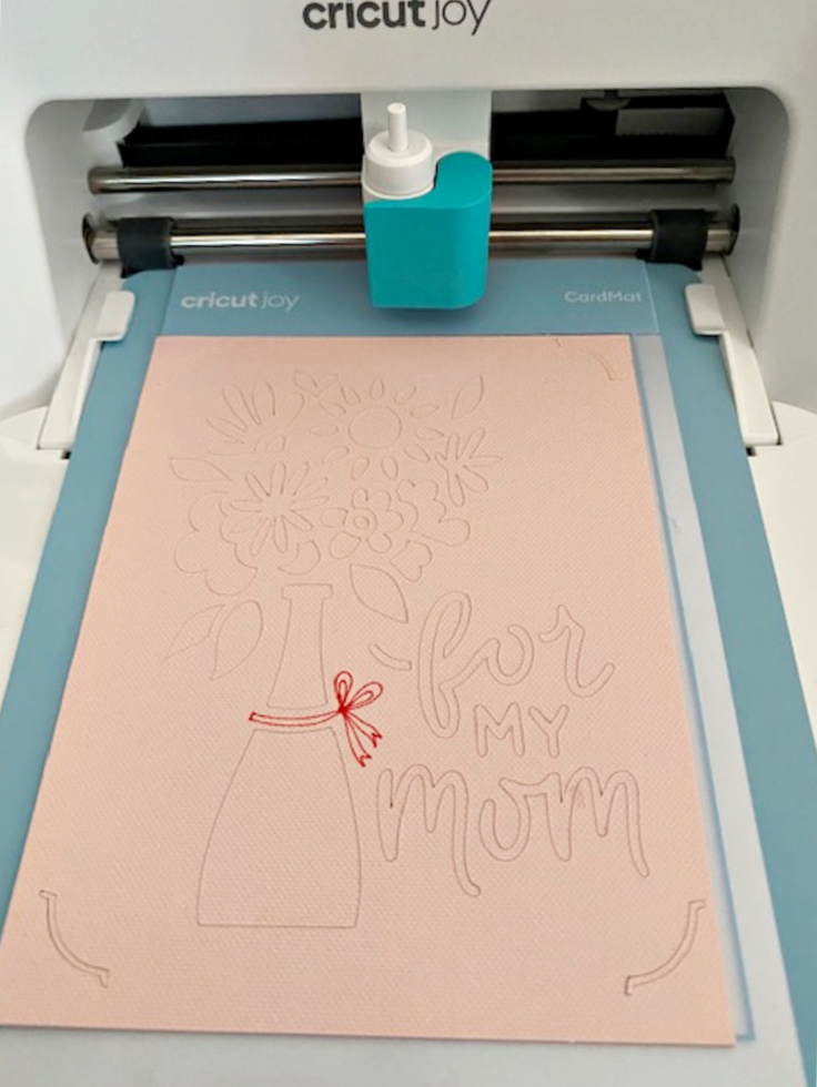 loading the card onto cricut joy