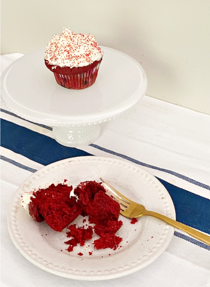 red velvet cupcake on plate with fork