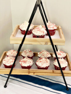 red velvet cupcakes on decocrated stand
