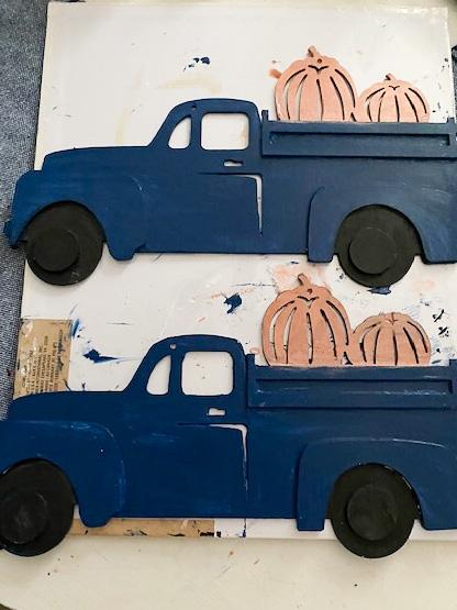 2 painted blue trucks