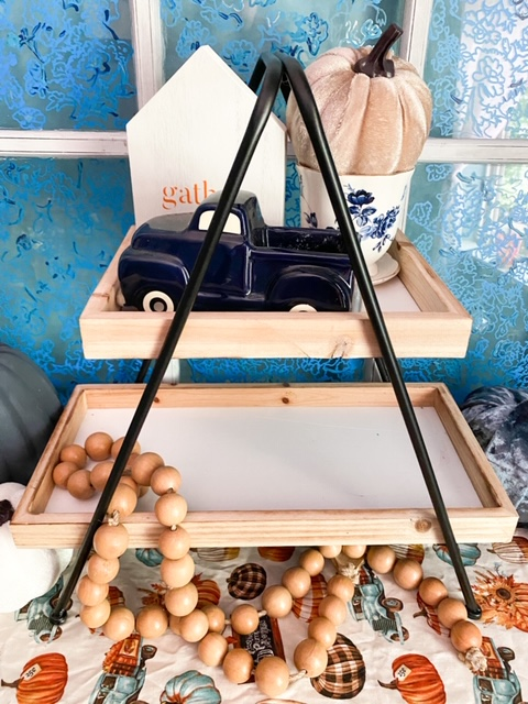 fall tiered tray with blue truck and wood beads