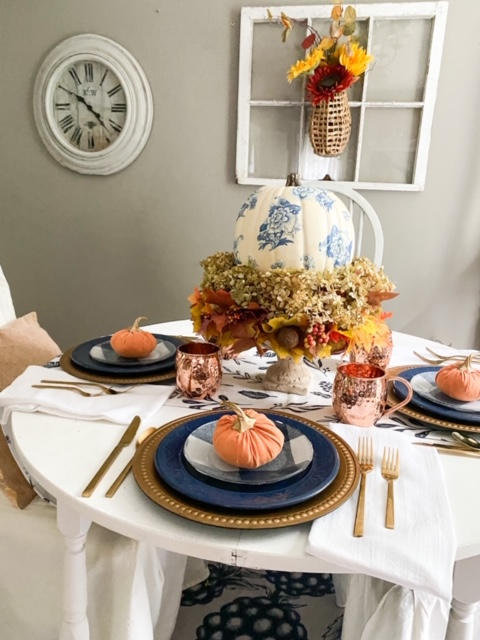 side view of blue and orange fall tablescape