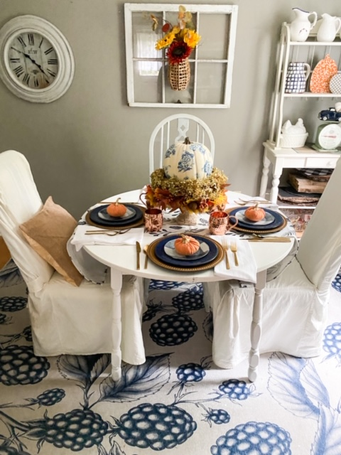 room view blue and orange fall tablescape