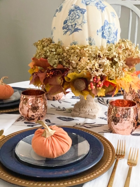 close up fall tablescape blue and orange