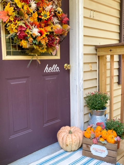 front door decorated for fall with decocrated basket
