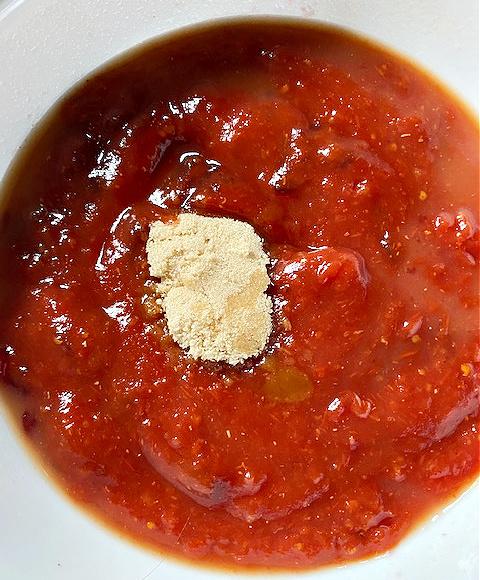 mixing cranberry sauce