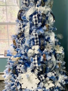 blue flocked Christmas tree with layered ribbon