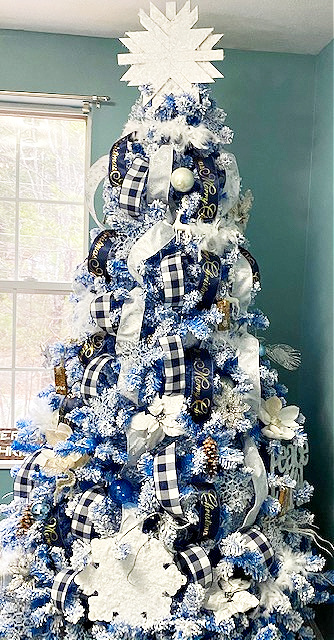full view blue flocked Christmas tree