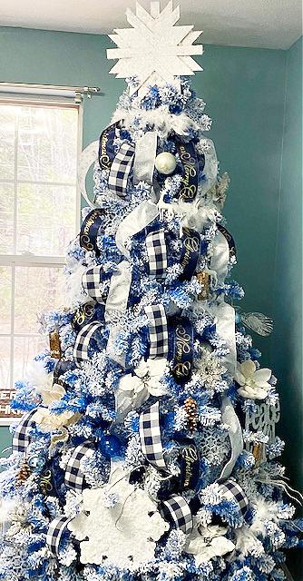 full view blue flocked Christmas tree