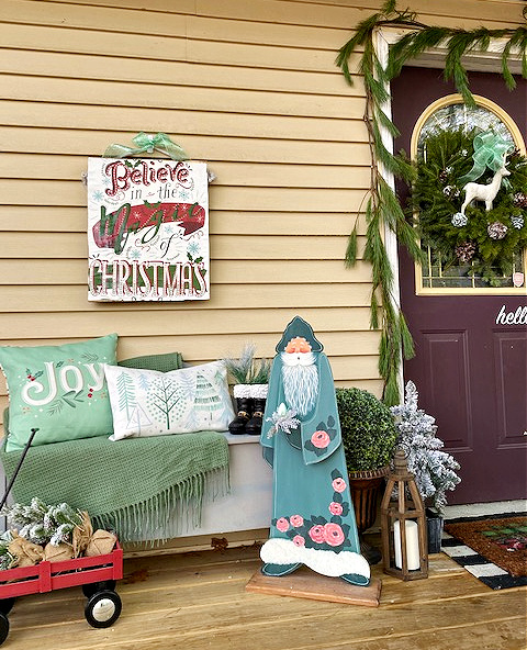 christmas front porch with fresh pine garland