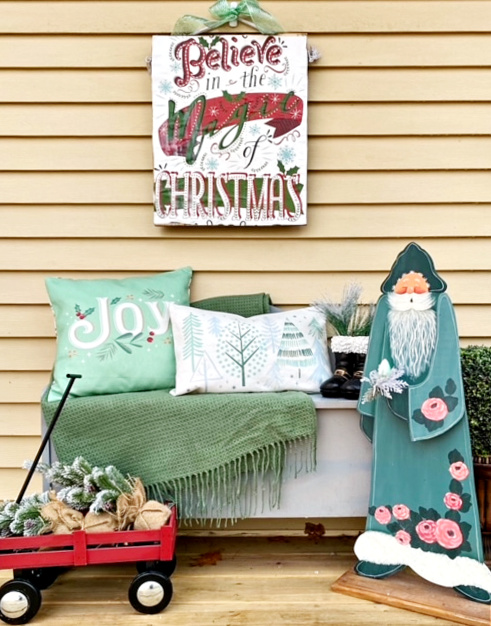 diy pallet wood christmas sign with gift bag from dollar store