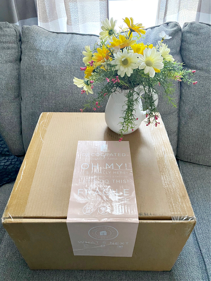 decocrated spring box with vase of flowers
