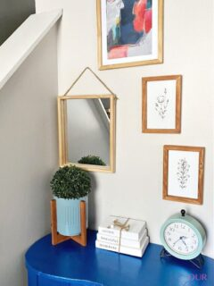 gallery wall with blue desk decocrated items