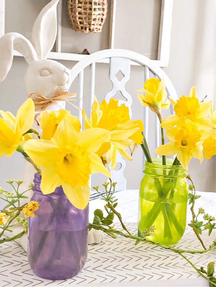 tinted mason jars with daffodils
